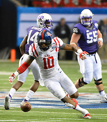 Mississippi Rebels defensive end C.J. Johnson (10) recovers the TCU fumble in the first half of the Ole Miss vs. TCU Chick-fil-A Peach Bowl football game at the Georgia Dome on December 31, 2014. David Tulis / Abell Images for the Chick-fil-A Bowl