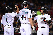 PHOENIX, AZ - JULY 05:  Rickie Weeks #5 of the Arizona Diamondbacks is congratulate by Michael Bourn #1 and Paul Goldschmidt #44 after hitting a three run home during the third inning San Diego Padres at Chase Field on July 5, 2016 in Phoenix, Arizona.  (Photo by Jennifer Stewart/Getty Images)
