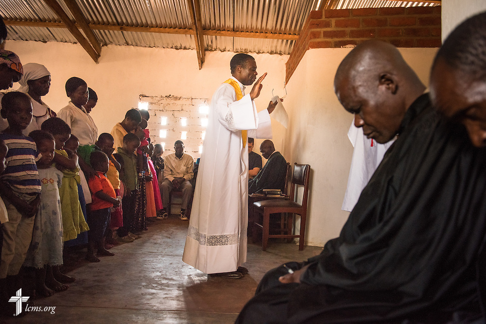 The Rev. Davis Wowa, executive chairman of the Confessional Lutheran Church–Malawi Synod, prays during worship on Sunday, Sept. 27, 2015, at a parish in Chingale, Malawi. LCMS Communications/Erik M. Lunsford