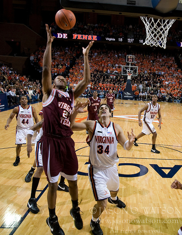 Virginia Tech forward Lewis Witcher (21) grabs a rebound against Virginia.  The Virginia Cavaliers men's basketball team fell to the Virginia Tech Hokies 70-69 in overtime at the John Paul Jones Arena in Charlottesville, VA on January 16, 2008.