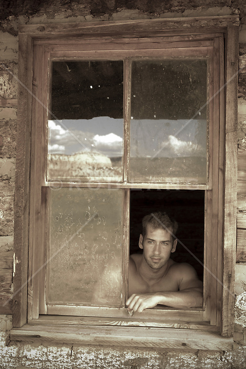 Handsome man in a window
