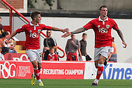 Aden Flint (right) of Bristol City celebrates scoring his sides first goal with his team mate Joe Bryan (left) during the Sky Bet League 1 match at Ashton Gate, Bristol<br /> Picture by Tom Smith/Focus Images Ltd 07545141164<br /> 06/09/2014