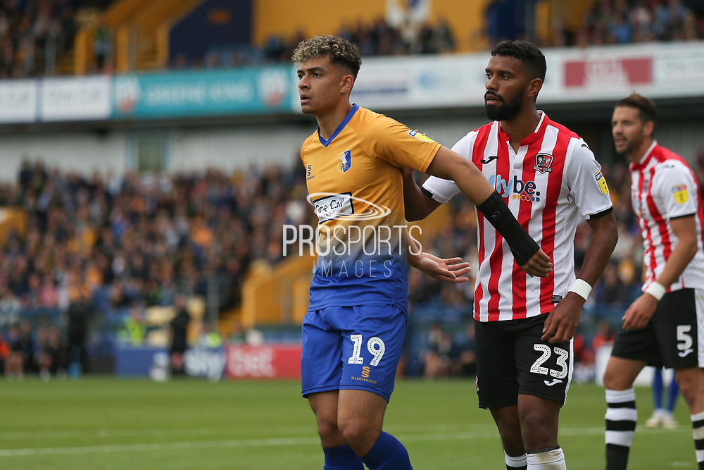 Luke Croll of Exeter City (23) marks Tyler Walker of Mansfield Town (19) during the EFL Sky Bet League 2 match between Mansfield Town and Exeter City at the One Call Stadium, Mansfield, England on 15 September 2018.