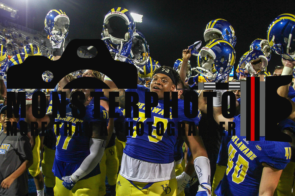 Delaware player sing their fight song after defending Delaware State 56-14 during a week one game between the Delaware Blue Hens and the Delaware State Hornets, Thursday, Sept. 01, 2016 at Tubby Raymond Field at Delaware Stadium in Newark, DE.
