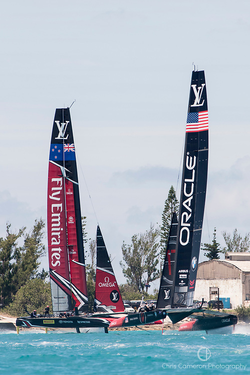 The Great Sound, Bermuda, 25th June 2017. Emirates Team New Zealand and Oracle Team USA meet up in the start box for race seven. Day four of racing in the America's Cup presented by Louis Vuitton.