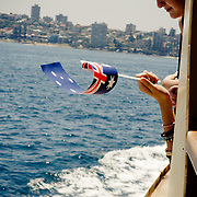 hand hanging Australian flag aboard a ferry During Australia Day.