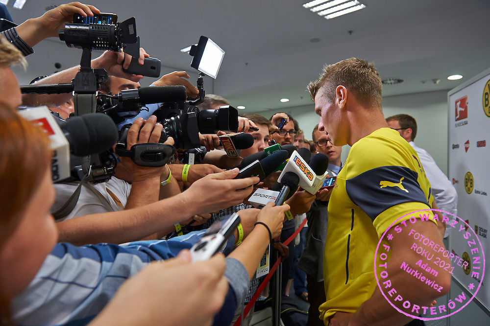Lukasz Piszczek of Dorussia Dortmund while interview in mixed zone after international friendly soccer match between WKS Slask Wroclaw and BVB Borussia Dortmund on Municipal Stadium in Wroclaw, Poland.<br /> <br /> Poland, Wroclaw, August 6, 2014<br /> <br /> Picture also available in RAW (NEF) or TIFF format on special request.<br /> <br /> For editorial use only. Any commercial or promotional use requires permission.<br /> <br /> Mandatory credit:<br /> Photo by &copy; Adam Nurkiewicz / Mediasport