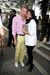 HENRY CONWAY and MARTINE MCCUTCHEON at The Ralph Lauren Sony Ericsson WTA Tour Pre-Wimbledon Party hosted by Richard Branson at The Roof Gardens on June 18, 2009