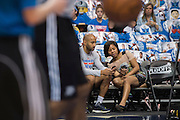 Amanda Green, basketball operations coordinator for the Oklahoma City Thunder, visits with Mark Simpson, director of performance science, during warmups before a playoff game against the Dallas Mavericks in Dallas, Texas on April 21, 2016. (Cooper Neill for The New York Times)