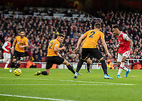 Football - 2019 / 2020 Premier League - Arsenal vs. Wolverhampton Wanderers<br /> <br /> Pierre-Emerick Aubameyang (Arsenal FC) side foots home his shot to give his team the lead at The Emirates Stadium.<br /> <br /> COLORSPORT/DANIEL BEARHAM