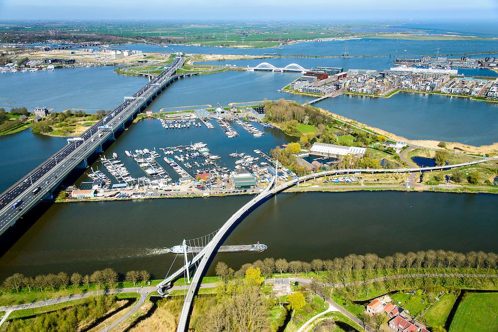 Nederland, Noord-Holland, Amsterdam, 20-04-2015; Zeeburgerbrug (Ringweg A 10) over water van het Nieuwe Diep en IJmeer (Buiten-IJ). Foto richting Eiland Zeeburg (Zeeburger eiland), rechts IJburg. Amsterdam-Rijnkanaal met Nesciobrug in de voorgrond.<br /> Amsterdam Ring Road near IJburg, the new urban development district of Amsterdam.<br /> luchtfoto (toeslag op standard tarieven);<br /> aerial photo (additional fee required);<br /> copyright foto/photo Siebe Swart