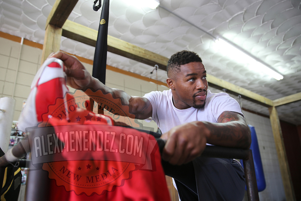 """WINTER HAVEN, FL - MAY 05: Boxer Willie Monroe Jr. stretches prior to his work out at the Winter Haven Boxing Gym on May 5, 2015 in Winter Haven, Florida. Monroe will challenge middleweight world champion Gennady """"GGG"""" Golovkin for the WBA world championship title in Los Angeles on May 16.  (Photo by Alex Menendez/Getty Images) *** Local Caption *** Willie Monroe Jr."""