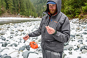 David Page strings up his spey rod. Gold River, Vancouver Island, BC
