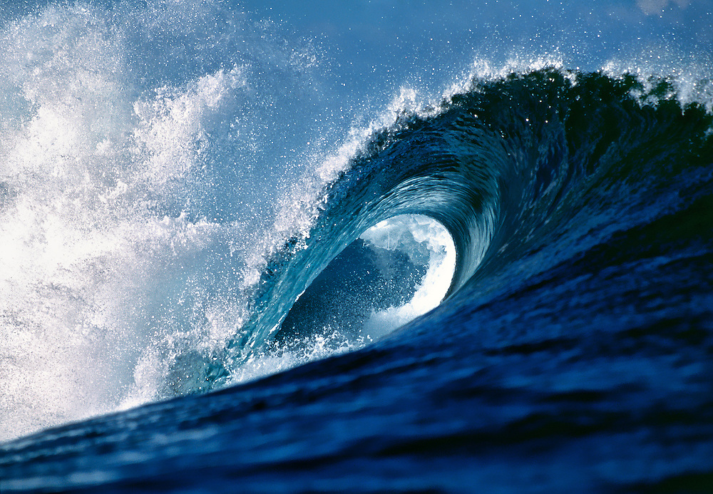 An open wave creates a perfect curl at Cloudbreak Reef off Tavarua Island, Fiji.