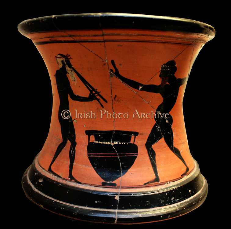 Greek stand showing black-figures of revellers. Made in Athens circa 520-500 BC.