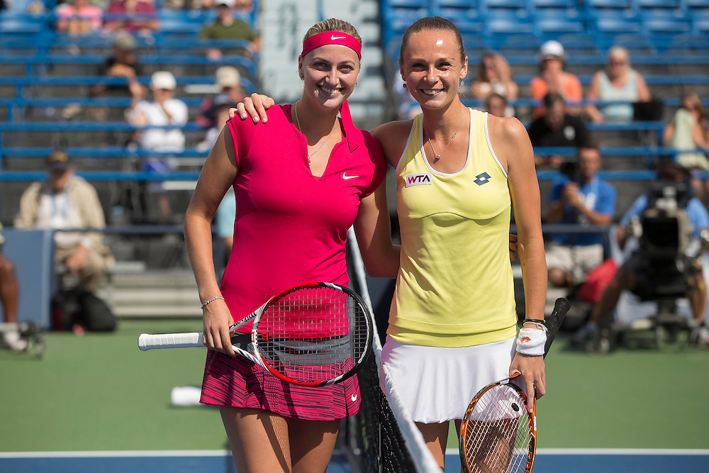 August 23, 2014, New Haven, CT:<br /> Magdalena Rybarikova and Petra Kvitova pose for a photograph during a coin toss ceremony before the singles final on day nine of the 2014 Connecticut Open at the Yale University Tennis Center in New Haven, Connecticut Saturday, August 23, 2014.<br /> (Photo by Billie Weiss/Connecticut Open)