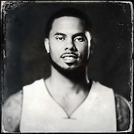 Sep 29, 2014; Auburn Hills, MI, USA;  (Editor's Note: Photo was post-processed creating a digital tintype) Detroit Pistons guard D.J. Augustin (14) during media day at the Pistons practice facility. Mandatory Credit: Rick Osentoski-USA TODAY Sports