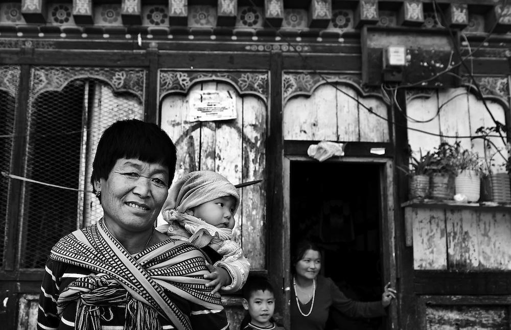 A family living near Trongsa Dzong, Bhutan.