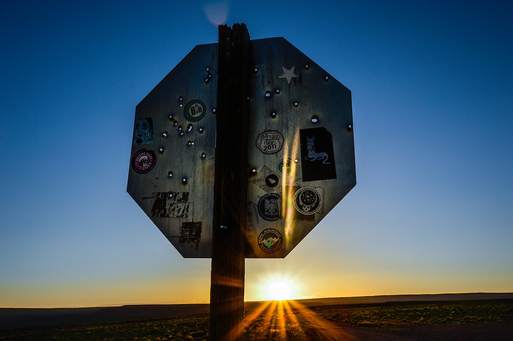 This sign is located in the Monument Valley Utah, it has a lot holes made by bullets.