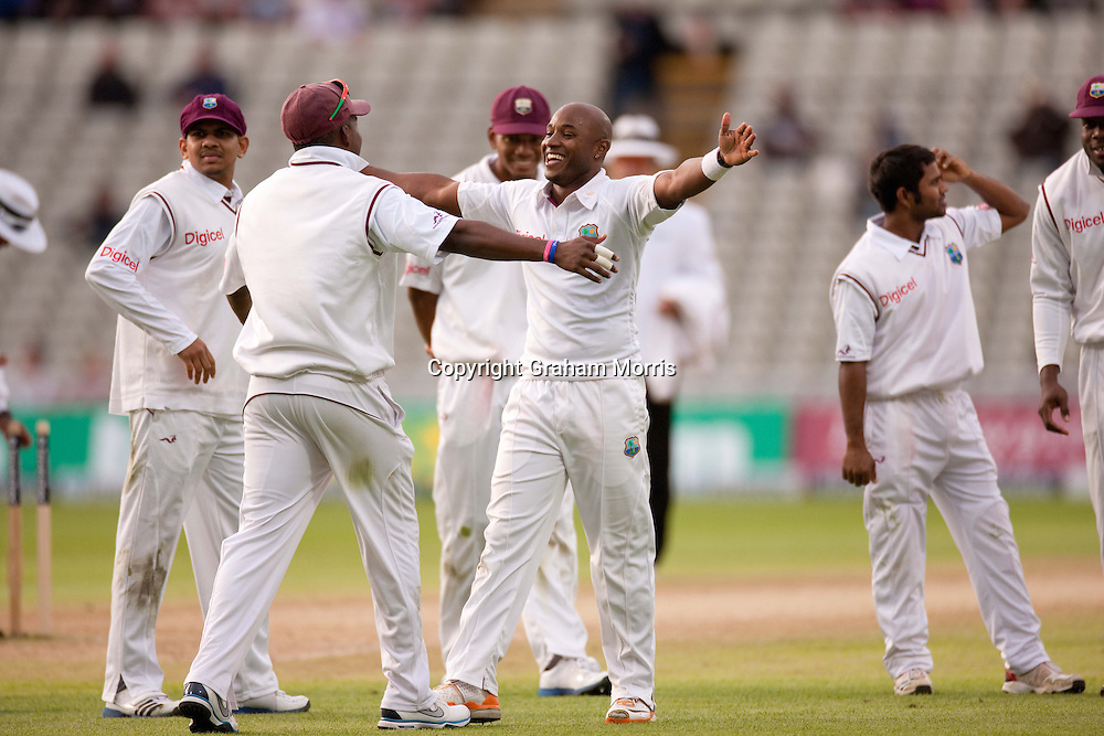 Tino Best celebrates bowling Jonny Bairstow during the third and final Investec Test Match between England and West Indies at Edgbaston, Birmingham. Photo: Graham Morris (Tel: +44(0)20 8969 4192 Email: sales@cricketpix.com) 10/06/12
