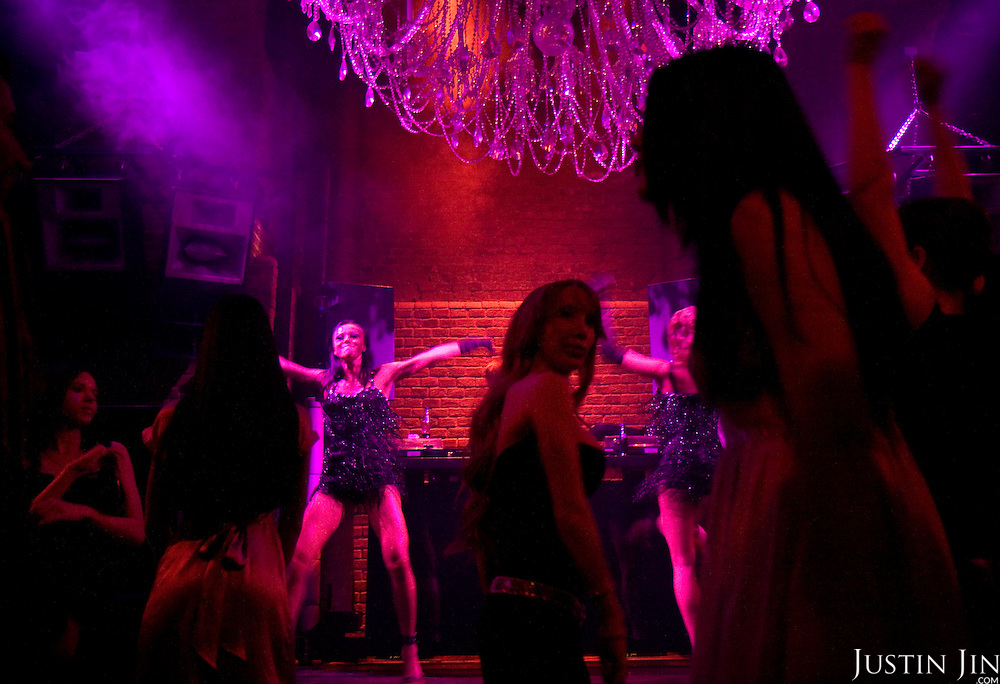 Models dance in the MOST Club in Moscow while clients enjoy themselves. MOST is one of Moscow's elite nightclub.