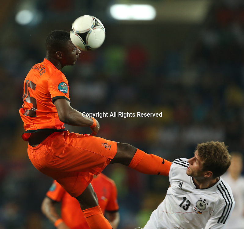 13.06.2012 Ukraine, Kharkiv.  Netherlands national team player Jetro Willems (left) and German national team player Thomas Müller in the group stage European Football Championship match between teams of the Netherlands and Germany.