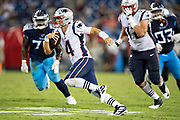 NASHVILLE, TN - AUGUST 17:  Jarrett Stidham #4 of the New England Patriots runs the ball during a game against the Tennessee Titans during week two of the preseason at Nissan Stadium on August 17, 2019 in Nashville, Tennessee.  The Patriots defeated the Titans 22-17.  (Photo by Wesley Hitt/Getty Images) *** Local Caption *** Jarrett Stidham