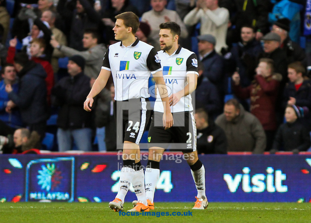 Picture by Tom Smith/Focus Images Ltd 07545141164<br /> 01/02/2014<br /> Ryan Bennett (left) and Russell Martin (right) of Norwich City can not believe it as Cardiff take the lead during the Barclays Premier League match at the Cardiff City Stadium, Cardiff.