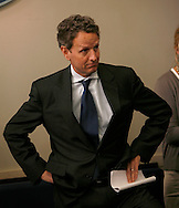 Secretary of The Treasury Timothy Geithner wait for  Press Secretary Robert Gibbs to introduce him at the briefing in the White House Press Briefing Room on April 14, 2010.  Photo by Dennis Brack