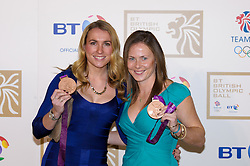 Hockey stars Laura Bartlett and Sarah Thomas during the BT Olympic Ball, held at the Grosvenor Hotel, London, UK, November 30, 2012. Photo By Anthony Upton / i-Images.