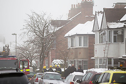 © Licensed to London News Pictures. 22/01/2013. London, UK. Emergency services are seen outside a house in North Finchley, London, today (22/01/13) after a house fire claimed the lives of two people this morning morning. The cause of the blaze, which took two hours to get under control and involved six fire engines and 35 fire fighters, is currently under investigation. Photo credit: Matt Cetti-Roberts/LNP