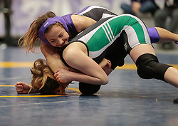 London, Ontario ---2013-03-02--- Silke Svenkeson of The University Of Saskatchewan takes on Alyssa Medeiros of Western in the women's 51 KG 5th/6th match at the 2012 CIS Wrestling Championships in London, Ontario, March 02, 2013. .GEOFF ROBINS/Mundo Sport Images