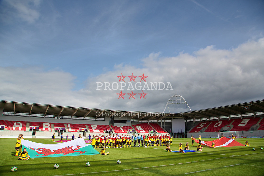 LLANELLI, WALES - Monday, August 19, 2013: Wales and Denmark line-up before the opening Group A match of the UEFA Women's Under-19 Championship Wales 2013 tournament at Parc y Scarlets. (Pic by David Rawcliffe/Propaganda)