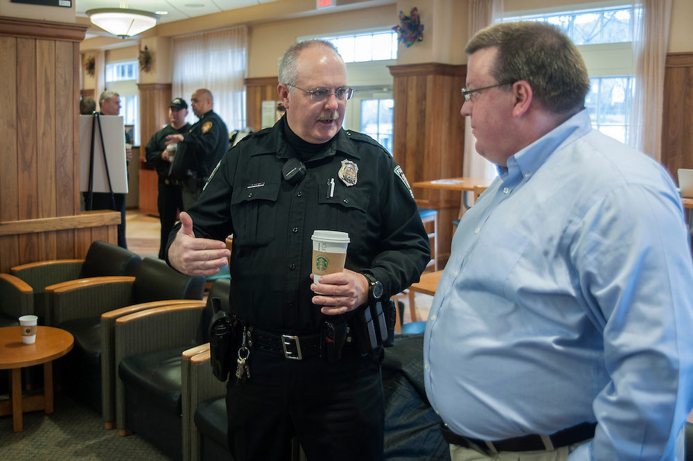 "Officer R. Comer speaks with T. David Curp in The Front Room Coffee House on Thursday, January 22 for ""Coffee with a Cop."" The event encouraged members of the commuity to spend time getting aquainted with law enforcement officials."