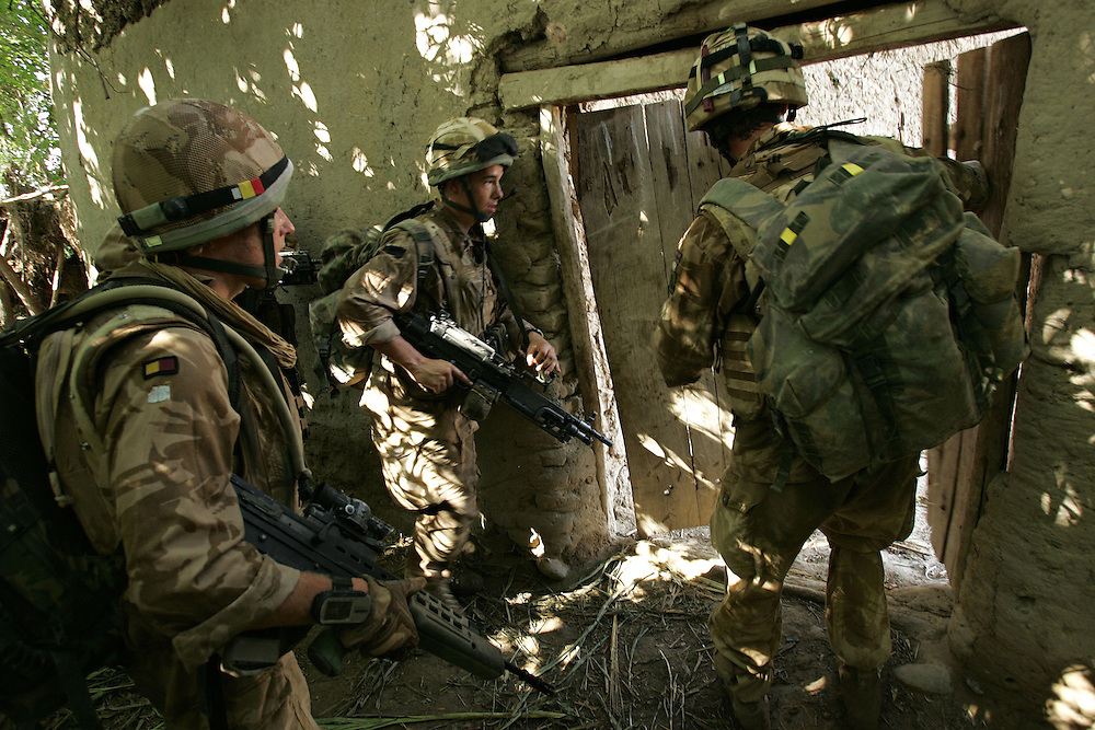 29/06/07..Sangin Valley, Helmand, Afghanistan..Soldiers from A Company 1 Battalion Royal Anglians, known as 'The Vikings' break down a door to gain entry to a compound whilst conducting operations against the Taliban in the Sangin Valley, Helmand province, Afghanistan on the 29th June 2007...The soldiers made a Tactical Advance to Battle over night carrying just food, water and ammunition. At first light they moved on their objectives; a series of compounds, orchards and paddy fields. During the day they exchanged fire with the enemy on a number of occasions. 13 Taliban were killed, 1 British soldier and 3 Afghan troops were wounded.