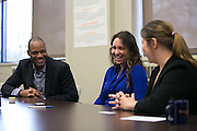 Lori Posato of Webster, center, speaks with Andrea Colline, Outreach Coordinator at Consumer Credit Counseling Services of Rochester, right, and Ajamu Kitwana, Consumer Prosperity Program Manager at ESL Federal Credit Union, on Friday, April 1, 2016. Posato is participating in the First Home Club administered by ESL, which provides a 4-to-1 match of her savings for her downpayment and closing costs.