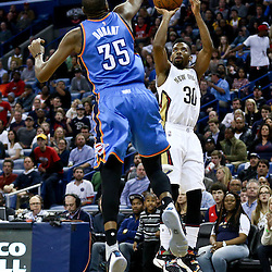 Feb 25, 2016; New Orleans, LA, USA; New Orleans Pelicans guard Norris Cole (30) shoots over Oklahoma City Thunder forward Kevin Durant (35) during the second half of a game at Smoothie King Center. The Pelicans defeated the Thunder 123-119. Mandatory Credit: Derick E. Hingle-USA TODAY Sports
