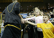 15 FEBRUARY 2007: Fans high five Iowa players as they run off the court before Iowa's 66-58 win over Northwestern at Carver-Hawkeye Arena in Iowa City, Iowa on February 15, 2007.