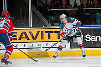 KELOWNA, CANADA - MARCH 5: Ryan Olsen #27 of the Kelowna Rockets takes a shot against the Spokane Chiefs on March 5, 2014 at Prospera Place in Kelowna, British Columbia, Canada.   (Photo by Marissa Baecker/Getty Images)  *** Local Caption *** Ryan Olsen;