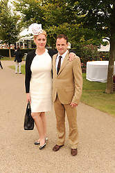 AMY SACCO and JONNY LEE MILLERat the third day of the 2010 Glorious Goodwood racing festival at Goodwood Racecourse, Chichester, West Sussex on 29th July 2010.