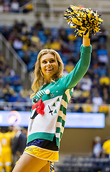 Dec 21, 2015; Morgantown, WV, USA; A West Virginia Mountaineers cheerleader performs during a timeout during the first half against the Eastern Kentucky Colonels at the WVU Coliseum. Mandatory Credit: Ben Queen-USA TODAY Sports