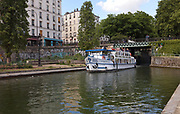 Pont Eugene-Varlin, a road bridge over the Canal Saint-Martin, at the Bassin des Recollets in the 10th arrondissement of Paris, France. The Canal Saint-Martin is a 4.6km long waterway between the Canal de l'Ourcq and river Seine, built 1802-25 to provide a fresh water source to the city and provide a trade route for canal barges. Picture by Manuel Cohen