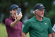 Hollywood star Jessica Alba  with her coach Greg Norman stops for a selfie