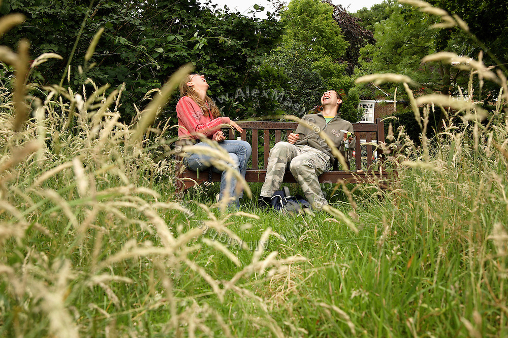 Romana, 28, from Czech Republic, (left) is laughing while having a wine bottle with Zil, 23, from Poland, (right) when sitting on a bench in Hampstead Heath, the famous London's park, only a few steps away from their houses, on Thursday, June 28, 2007, in Hampstead, London, England. Million Dollar Squatters is a documentary project in the lives of a peculiar group of squatters residing in three multi-million mansions in one of the classiest residential neighbourhoods of London, Hampstead Garden. The squatters' enthusiasm, their constant efforts to look after what has become their home, their ingenuity and adventurous spirit have all inspired me throughout the days and nights spent at their side. Between the fantasy world of exclusive Britain and the reality of squatting in London, I have been a witness to their unique story. While more than 100.000 properties in London still lay empty to this day, squatting provides a valid, and lawful alternative to paying Europe's most expensive rent prices, as well as offering the challenge of an adventurous lifestyle in the capital.