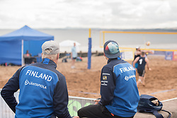The Commonwealth Games Queen's Baton came to Portobello Beach and it still wasn't the biggest thing happening there. The Big Beach Busk, now in its eighth year was just getting underway when the Baton arrived at the beach volleyball courts by Portobello Baths where a Men's CEV Continental Tour competition was underway. Pictured: Finnish Beach Volleyball team wait to get onto the court.<br /> <br /> <br /> © Jon Davey/ EEm