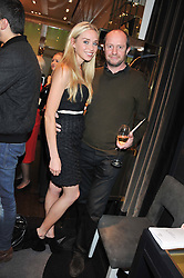 NOELLE RENO and SCOT YOUNG at a private view of an exhibition 'Outside in Chelsea' held at Annoushka, 41 Cadogan Gardens, London SW3 on 2nd October 2012.