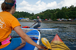 Dan Gauthier smiles as he is being instructed during his first attempts of using a stand-up paddle board.  (Bastiaan Slabbers/for PhillyVoice)