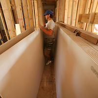 Adam Robison   BUY AT PHOTOS.DJOURNAL.COM<br /> Cody Merritt, a worker for CTC Drywall, prepares drywall for the interior of the Habitat for Humanity House located at 446 North Broadway Street in Tupelo.