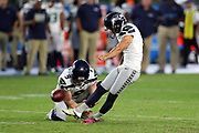 Seattle Seahawks quarterback Austin Davis (6) holds while Seattle Seahawks kicker Blair Walsh (7) kicks a fourth quarter extra point for a 48-17 Seahawks lead during the 2017 NFL week 1 preseason football game against the against the Los Angeles Chargers, Sunday, Aug. 13, 2017 in Carson, Calif. The Seahawks won the game 48-17. (©Paul Anthony Spinelli)