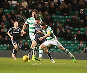 Dundee&rsquo;s Paul McGinn competes for the ball with Celtic's Scott Brown - Celtic v Dundee - Ladbrokes Scottish Premiership at Dens Park<br /> <br />  - &copy; David Young - www.davidyoungphoto.co.uk - email: davidyoungphoto@gmail.com